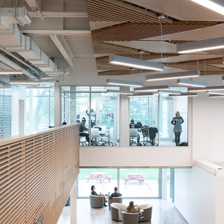 The Joyce Centre's central atrium provides ample views to the surrounding campus context and accommodates for a mix of private and public study spaces for its students.