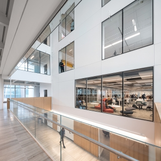 Driven by sunlight, flexible co-working spaces, labs and lecture theatres are centred around a light-filled atrium. The atrium functions as a social space that encourages formal and informal gatherings.