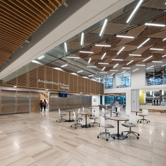 The interior material palette is balanced between robust steel and concrete and warmer materials such as wood and stone tile, to create a rich and inviting learning environment. All materials were locally sourced.