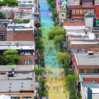 Aerial view of the multicolour balls installed overhead on Sainte-Catherine Street to maintain an unemcumbered streetscape