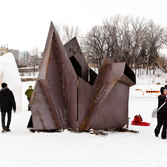 Removing corten formwork to reveal In The Light of Kudluk snow figures