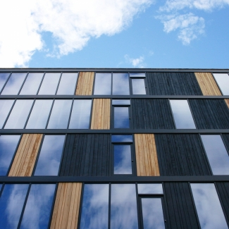 View of curtain wall and cedar cladding